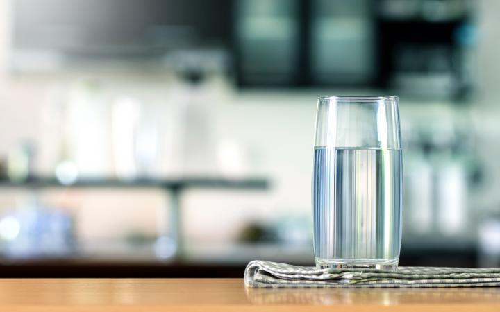 A glass of water on a benchtop