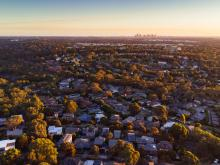 An image showing an aerial view of Macleod, the Victorian suburb, at sunset.